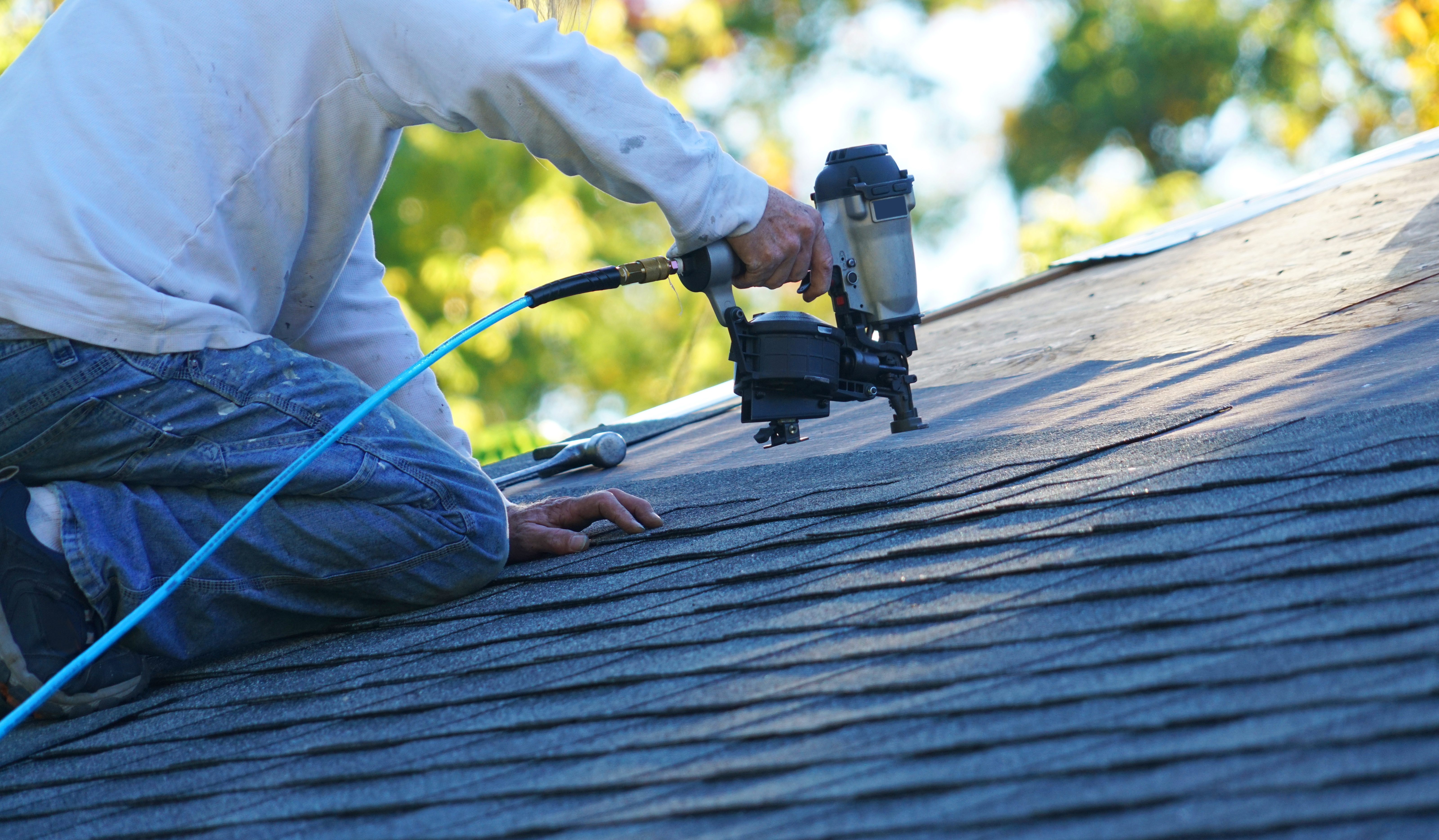 Roofer nail gun re-roof